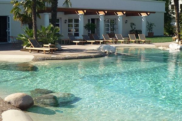Realizzazione giardini piscine biodesign firenze for Interrare piscina